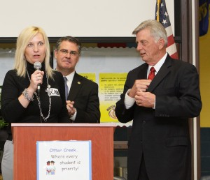 Zsuzsanna Diamond, 2012 Milken Award Winner, with Governor Mike Beebe and Dr. Gary Stark of the Milken Family Foundation